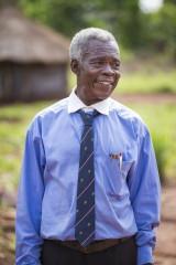 Hiệu trưởng Bakosa Mbikonyekinzi của trường tiểu học trong làng cảm thấy được khích lệ sau khi mất đi nhiều điều quan trọng vì LRA.