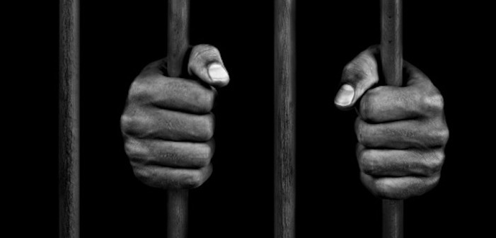 prison-bars-and-hands-used-in-banner-online-image-getty-images
