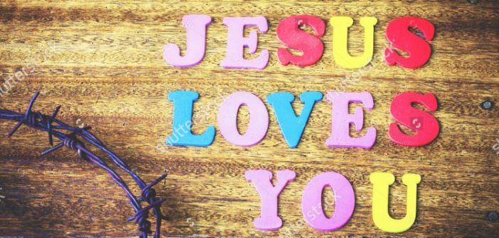 stock-photo-word-jesus-loves-you-design-by-colorful-wooden-letter-press-with-metal-crown-of-thorns-on-wooden-411967306